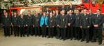 Oberbürgermeisterin Barbara Bosch und Bürgermeister Alexander Kreher mit den geehrten und beförderten Feuerwehrangehörigen
