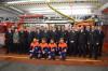 Das Bild zeigt die geehrten und beförderten Mitglieder der Feuerwehr zusammen mit der Abteilungsführung, dem Stv. Feuerwehrkommandanten Adrian Röhrle und der Stv. Bezirksbürgermeisterin Dagmar Krause