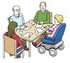 Das Bild zeigt vier Menschen, die zusammen an einem Tisch sitzen.
